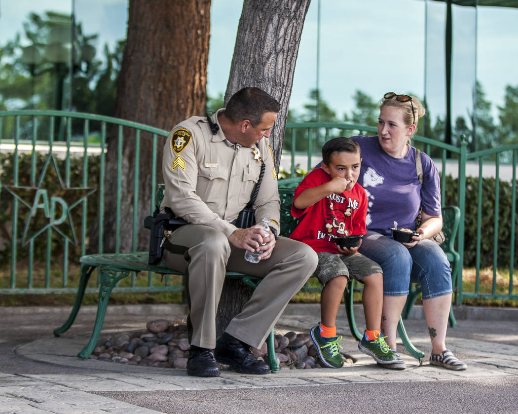 "Sgt. Steve Armbruster talks with Catherine and Aidan Ramos, 5, during a ""Chill with a Cop"" event hosted by Metropolitan Police Downtown Area Command at the Anderson Dairy in Las Vegas on Tuesday,  ..."