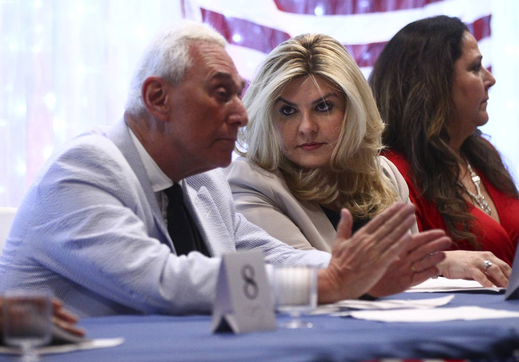 Political consultant Roger Stone, left, talks with Las Vegas City Councilwoman Michele Fiore at a fundraising event in support of the Bundy family at Rainbow Gardens in Las Vegas on Saturday, July ...