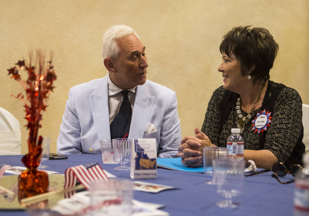 Political consultant Roger Stone, left, talks with Carol Bundy, wife of Cliven Bundy, at a fundraising event in support of the Bundy family at Rainbow Gardens in Las Vegas on Saturday, July 15, 20 ...