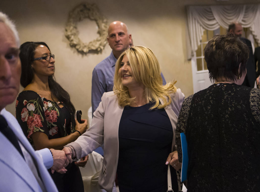 Las Vegas City Councilwoman Michele Fiore greets people at a fundraising event in support of the Bundy family at Rainbow Gardens in Las Vegas on Saturday, July 15, 2017. Chase Stevens Las Vegas Re ...
