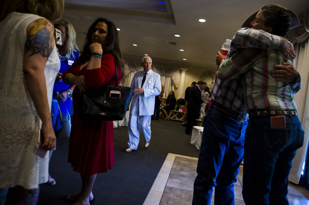 Political consultant Roger Stone, center, before speaking at a fundraising event in support of the Bundy family at Rainbow Gardens in Las Vegas on Saturday, July 15, 2017. Chase Stevens Las Vegas  ...