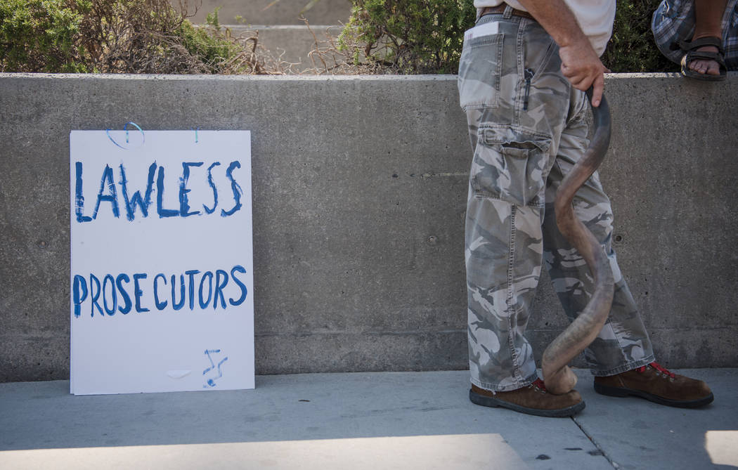 A sign is posted at a rally to support defendants in the Bundy standoff case at the Lloyd George U.S. Courthouse on Saturday, July 15, 2017, in Las Vegas. Morgan Lieberman Las Vegas Review-Journal