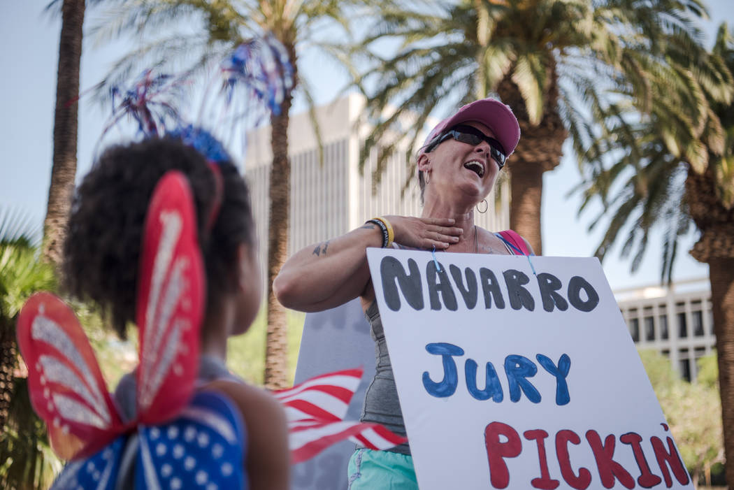 Oregon resident Mona Cleveland, chants in front of her daughter, Hanna, at a rally to support defendants in the Bundy standoff case at the Lloyd George U.S. Courthouse on Saturday, July 15, 2017,  ...