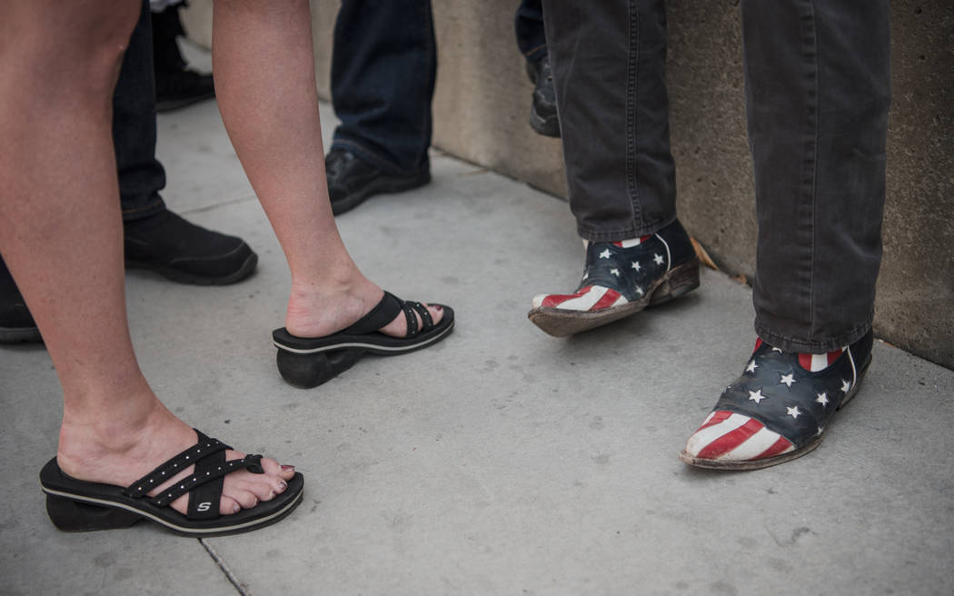 Journalist Charlie LeDuff wears American themed cowboy boots at a rally to support defendants in the Bundy standoff case at the Lloyd George U.S. Courthouse on Saturday, July 15, 2017, in Las Vega ...