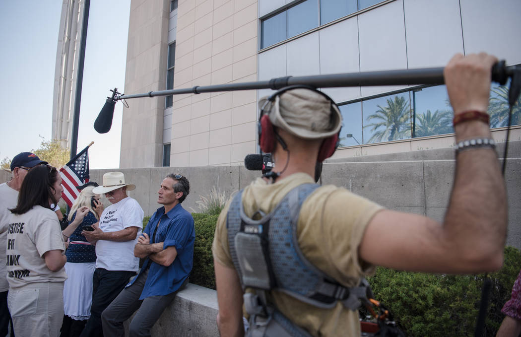 Journalist Charlie LeDuff, center, meets with protestors at a rally to support defendants in the Bundy standoff case at the Lloyd George U.S. Courthouse on Saturday, July 15, 2017, in Las Vegas. M ...