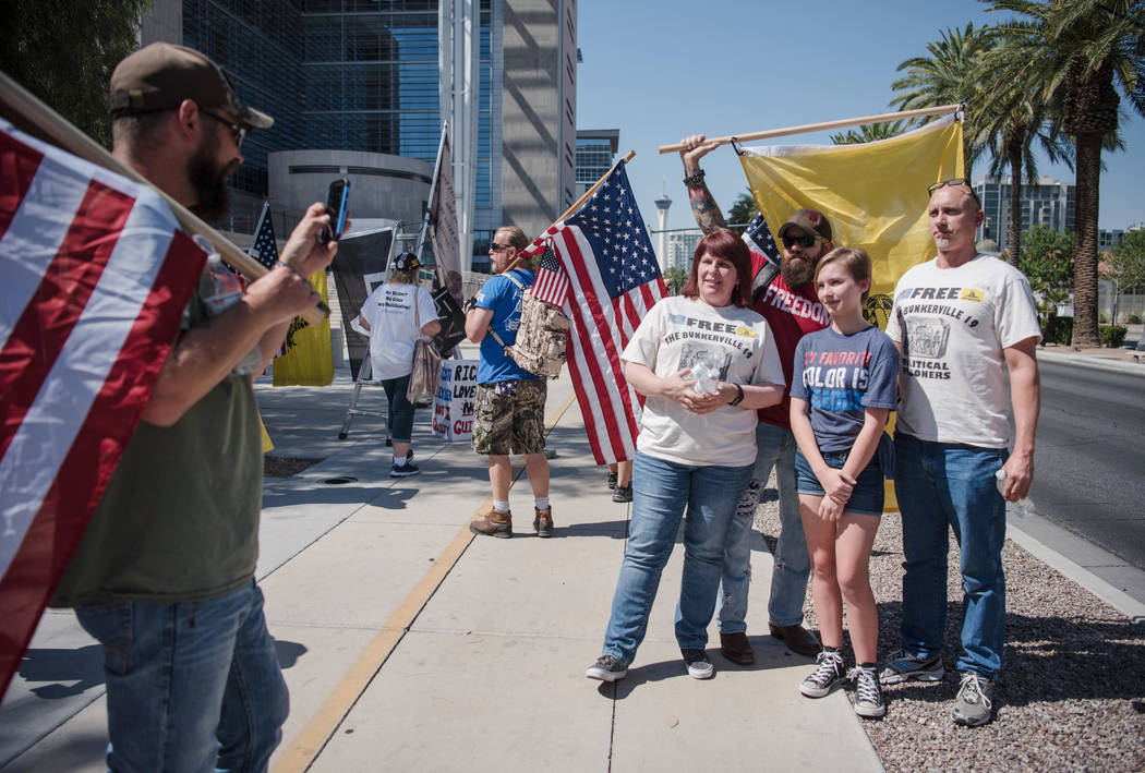 The Farnsley family from Phoenix gets their photo taken with Ace Baker, a leader of the American Warrior Revolution organization, at a rally to support defendants in the Bundy standoff case at the ...