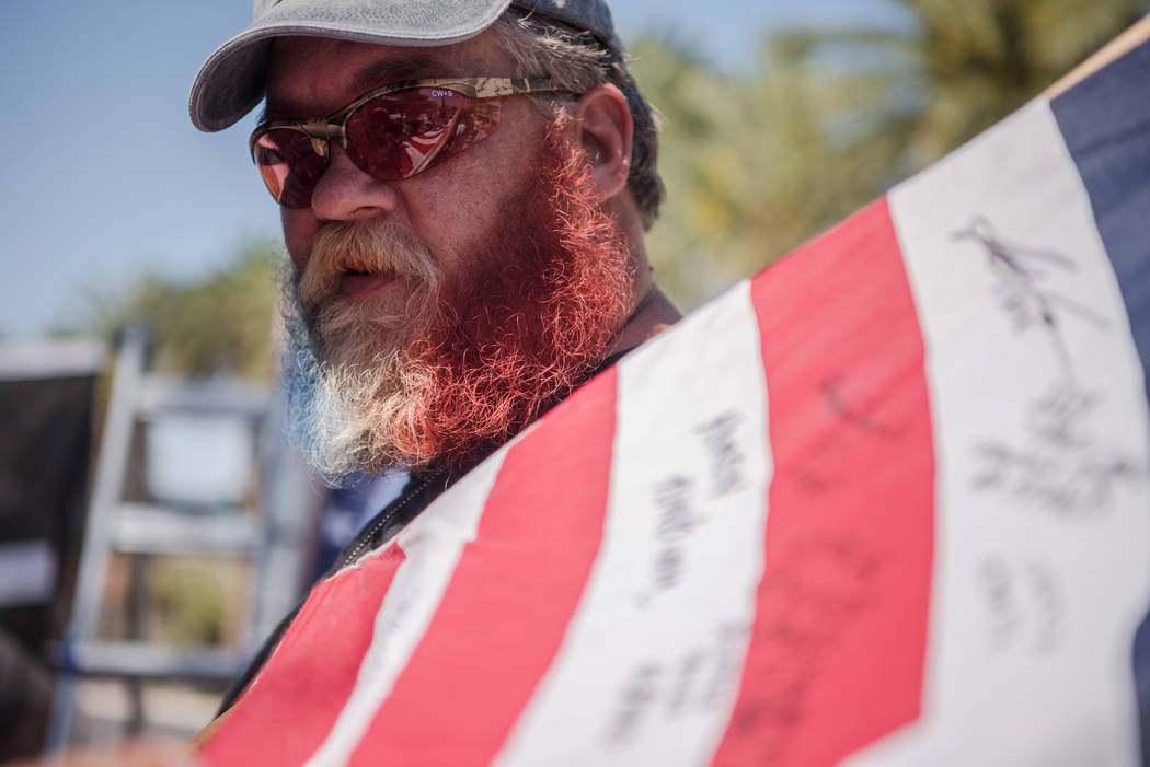 Georgia resident James Napier spray painted his beard the colors of the American flag at a rally to support defendants in the Bundy standoff case at the Lloyd George U.S. Courthouse on Saturday, J ...
