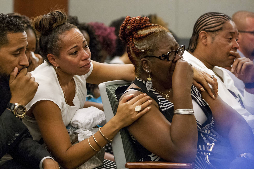 Ramona Gantz, center left, comforts Debra Pleasant, center right, the grandmother of Roland Pleasant, during sentencing for Eric Javon Bell at the Regional Justice Center in Las Vegas on Monday, J ...