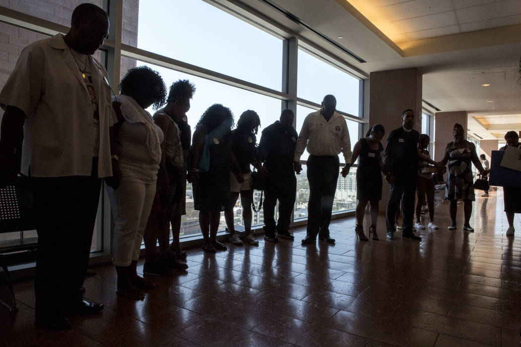 Family and friends of Roland Pleasant pray for justice before sentencing for Eric Javon Bell at the Regional Justice Center in Las Vegas on Monday, July 17, 2017. Bell pleaded guilty in May for ki ...