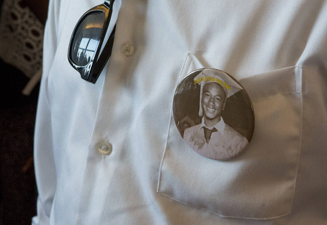 "Family and friends wear buttons that say ""Justice for Roland"" while gathering before sentencing for Eric Javon Bell at the Regional Justice Center in Las Vegas on Monday, July 17, 2017. Bell plead ..."