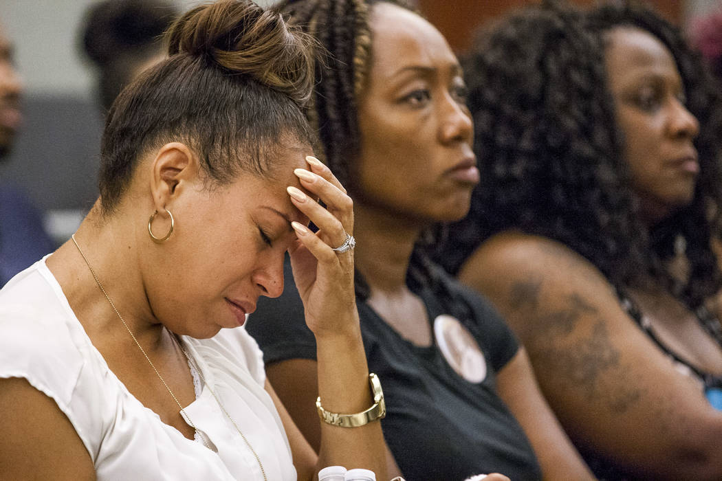 Ramona Gantz, left, a friend of Roland Pleasant's, holds her head in an emotional moment during sentencing for Eric Javon Bell at the Regional Justice Center in Las Vegas on Monday, July 17, 2017. ...