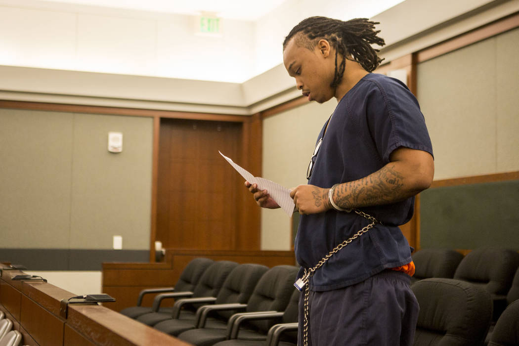 Eric Javon Bell reads a letter to the family of Roland Pleasant, asking for forgiveness after he pleaded guilty to killing 18-year-old Roland Pleasant, during his sentencing at the Regional Justic ...
