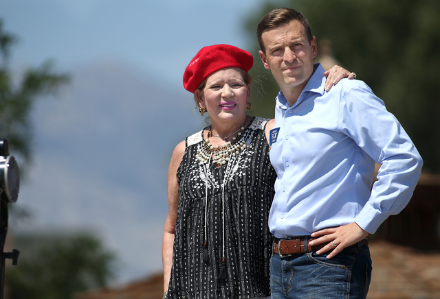 Nevada Attorney General Adam Laxalt and his mother Michelle look out over the crowd at the second annual Basque Fry in Gardnerville, Nev., on Saturday, Aug. 20, 2016. Laxalt and his political acti ...