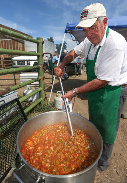 "Jesus Rey stirs a pot of ""lamb ball stew"" at the Inaugural Basque Fry event in Gardnerville, Nev., on Saturday, Aug. 15, 2015. Approximately 1,500 people attended to hear a handf ..."