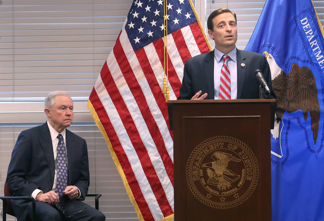 U.S. Attorney General Jeff Sessions, left, introduced by Nevada Attorney General Adam Laxalt on Wednesday, July 12, 2017, at the U.S. attorney's office in Las Vegas. Sessions spoke to federal, sta ...