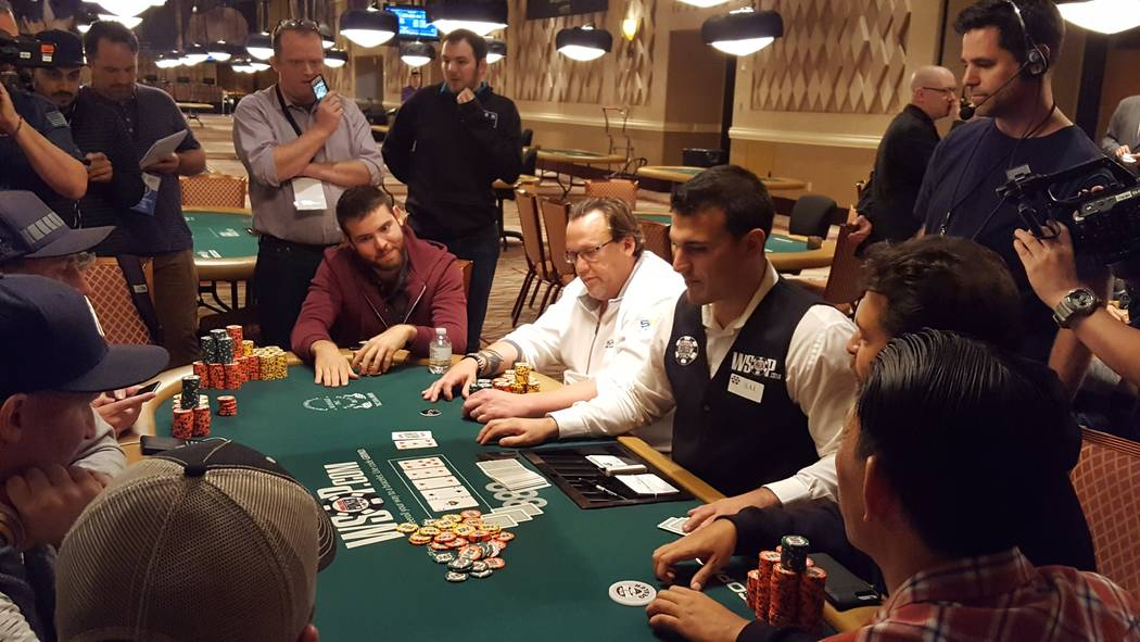 Mickey Craft (in white) shows a bluff to Amir Kaikhah late Friday on Day 4 of the World Series of Poker's $10,000 buy-in No-limit Texas Hold 'em World Championship at the Rio Convention Center.  ...