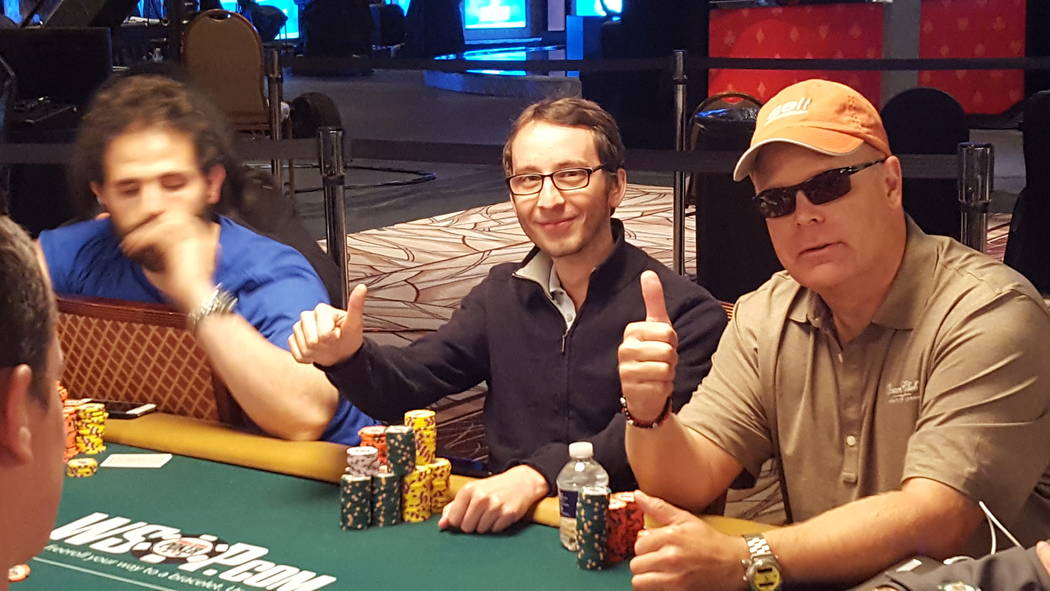 Sebastian Comel, center, poses with Graydon Kowal, right, during Day 4 of the World Series of Poker's $10,000 buy-in No-limit Texas Hold 'em World Championship Friday at the Rio Convention Cente ...
