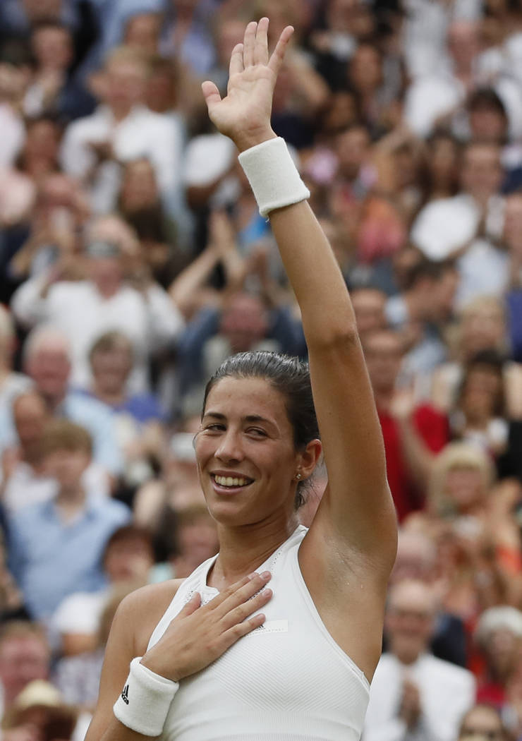 Spain's Garbine Muguruza celebrates after she dfeated Venus Williams of the United States to win the Women's Singles final match on day twelve at the Wimbledon Tennis Championships in London Satur ...