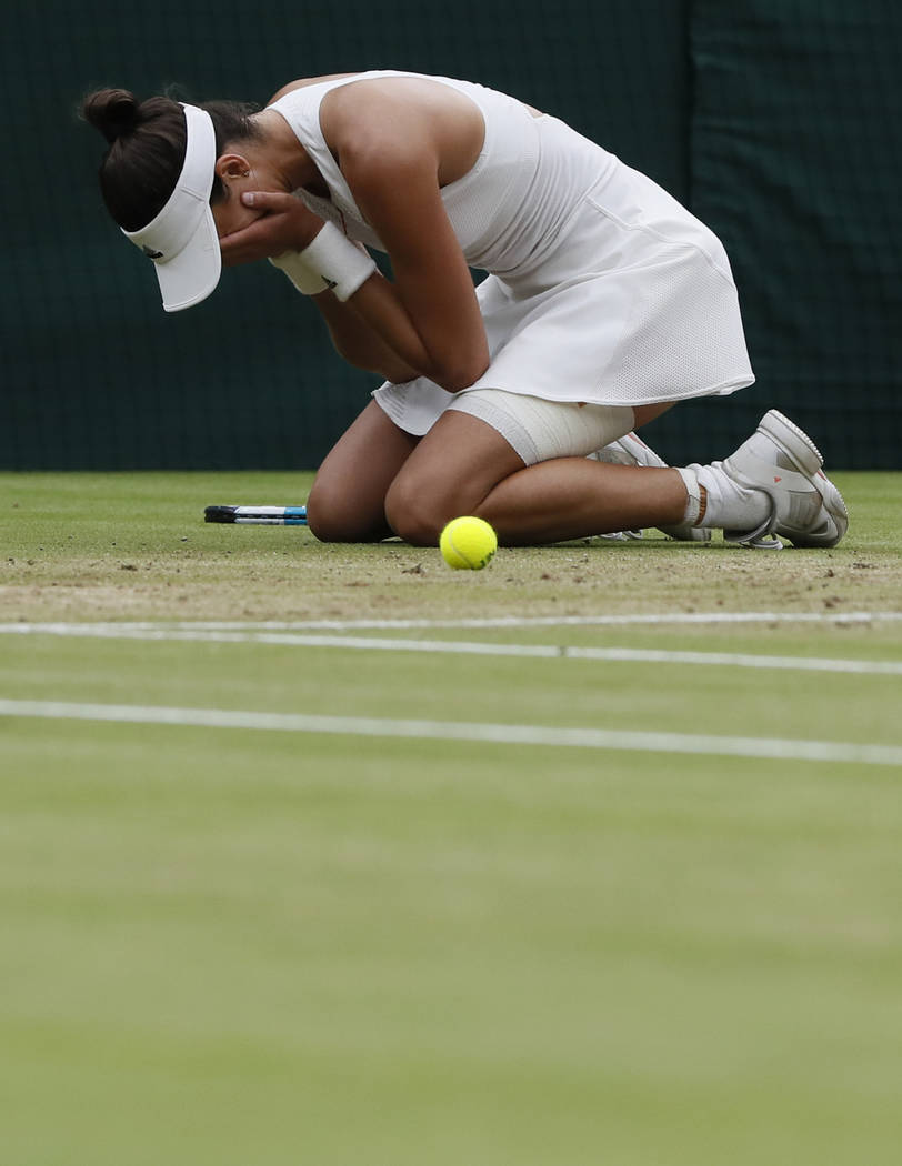 Spain's Garbine Muguruza celebrates as she beats Venus Williams of the United States to win the Women's Singles final match on day twelve at the Wimbledon Tennis Championships in London Saturday,  ...