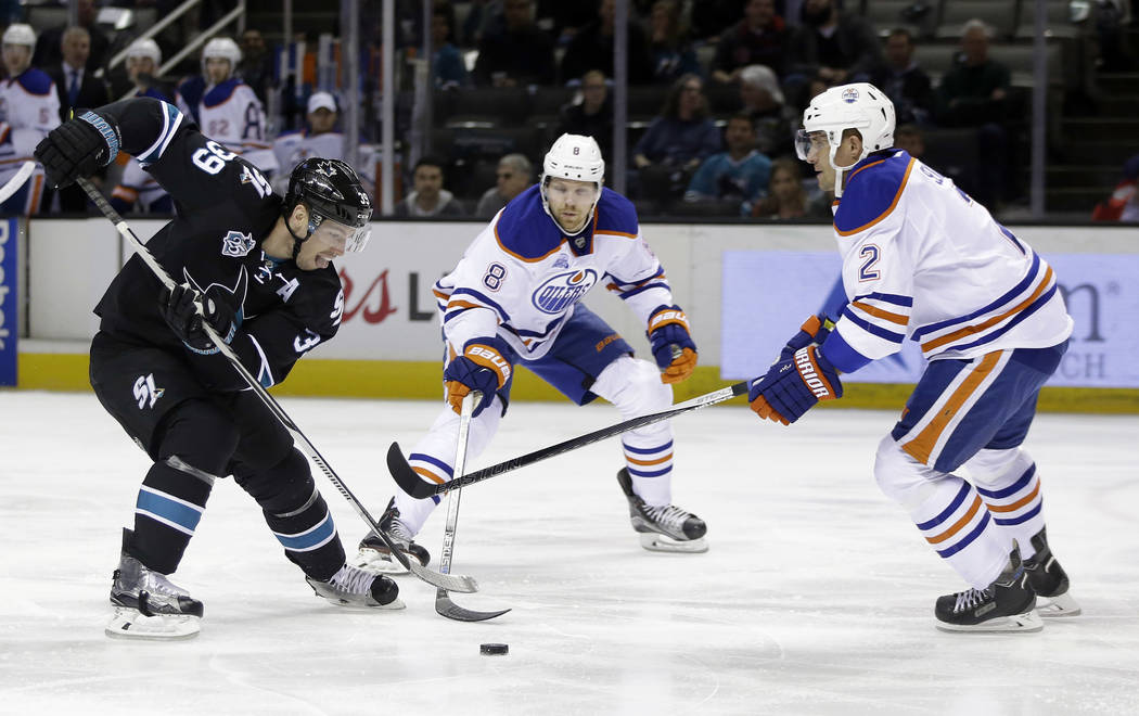 San Jose Sharks' Logan Couture (39) works against Edmonton Oilers' Griffin Reinhart (8) and Andrej Sekera (2) during the first period of an NHL hockey game Thursday, March 24, 2016, in San Jose, C ...