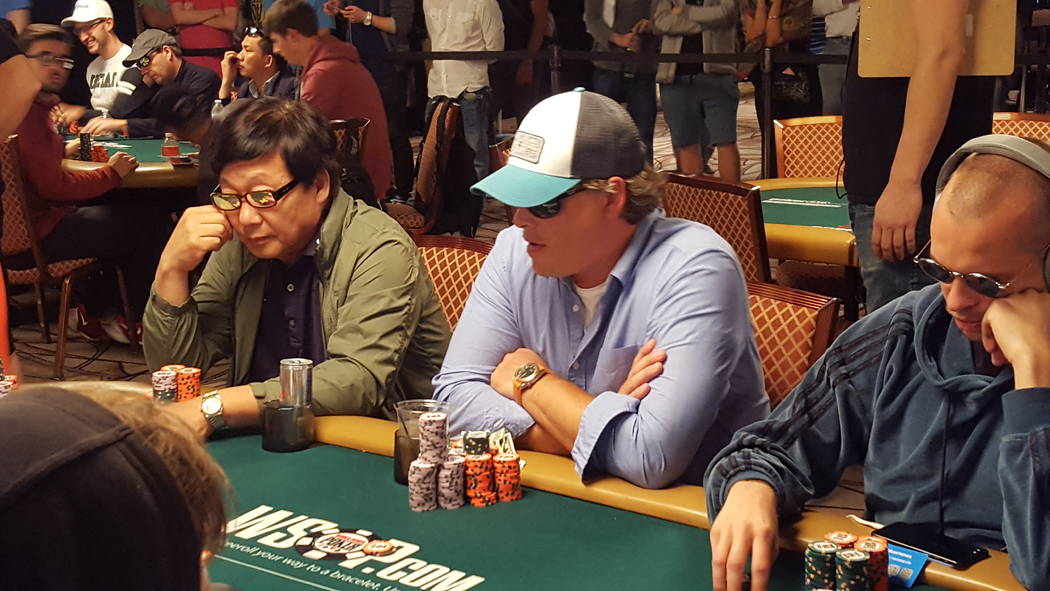 Joshua Horton, of Fort Payne, Alabama, center, is second in chips to start Day 6 of the World Series of Poker's $10,000 buy-in No-limit Texas Hold 'em World Championship at the Rio Convention Ce ...