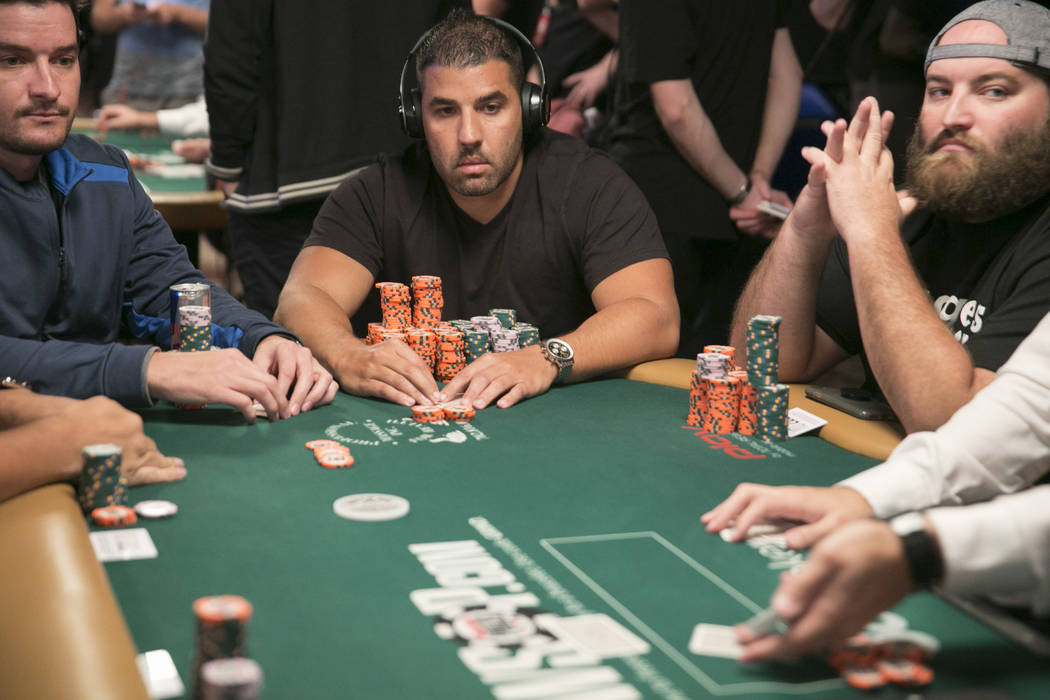Frank Crivello (center) waits for his turn during day five of The World Series of Poker at The Rio All-Suite Hotel and Casino in Las Vegas, Saturday, July 15, 2017. Crivello is in fourth place ove ...
