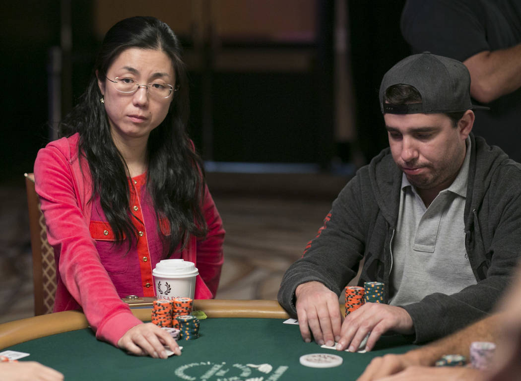Yuan Li, left, waits for her turn during day five of the World Series of Poker at The Rio All-Suite Hotel and Casino in Las Vegas, Saturday, July 15, 2017. Li was the final female competitor and w ...