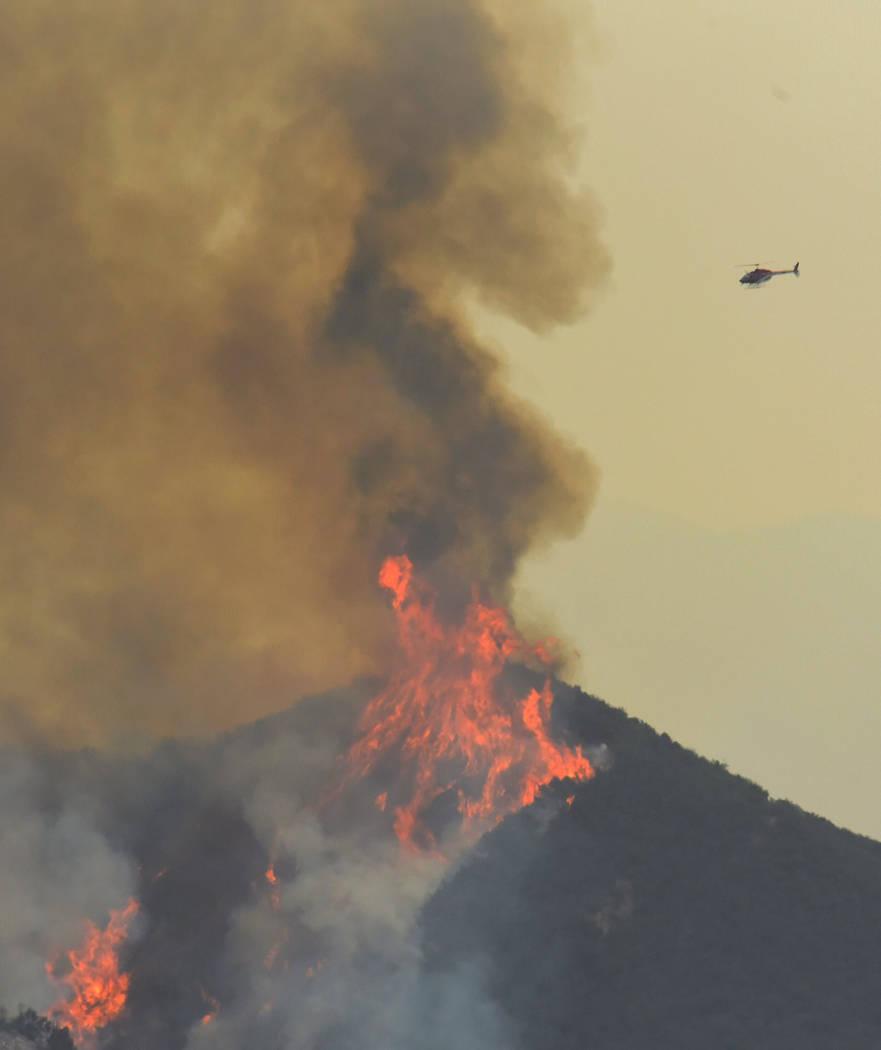 A reconnaissance helicopter surveys Whittier fire activity in Gato Canyon near Santa Barbara, California, U.S. July 15, 2017. (Mike Eliason/Santa Barbara County Fire Department/Handout via Reuters)
