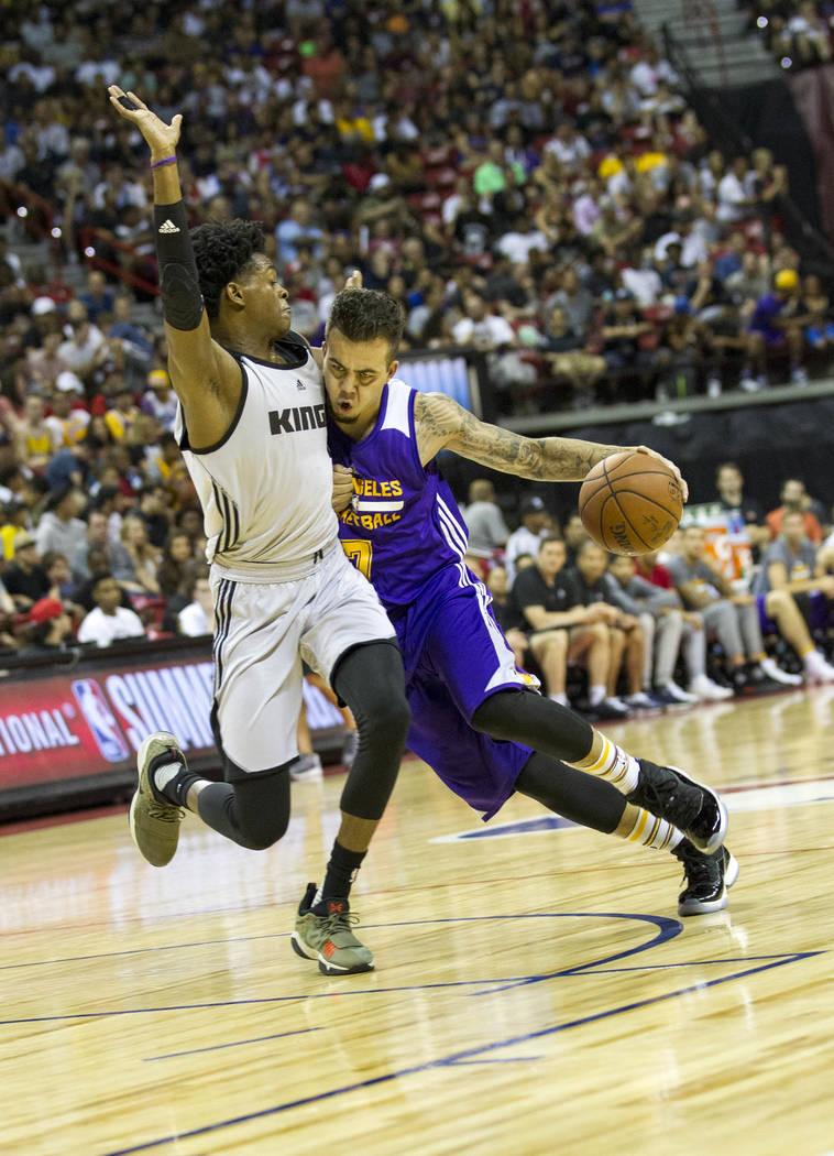 Sacramento Kings point guard De'Aaron Fox, left, pressures Los Angeles Lakers' Gabe York during the NBA summer league at the Thomas & Mack Center in Las Vegas, Monday, July 10, 2017. Richard B ...