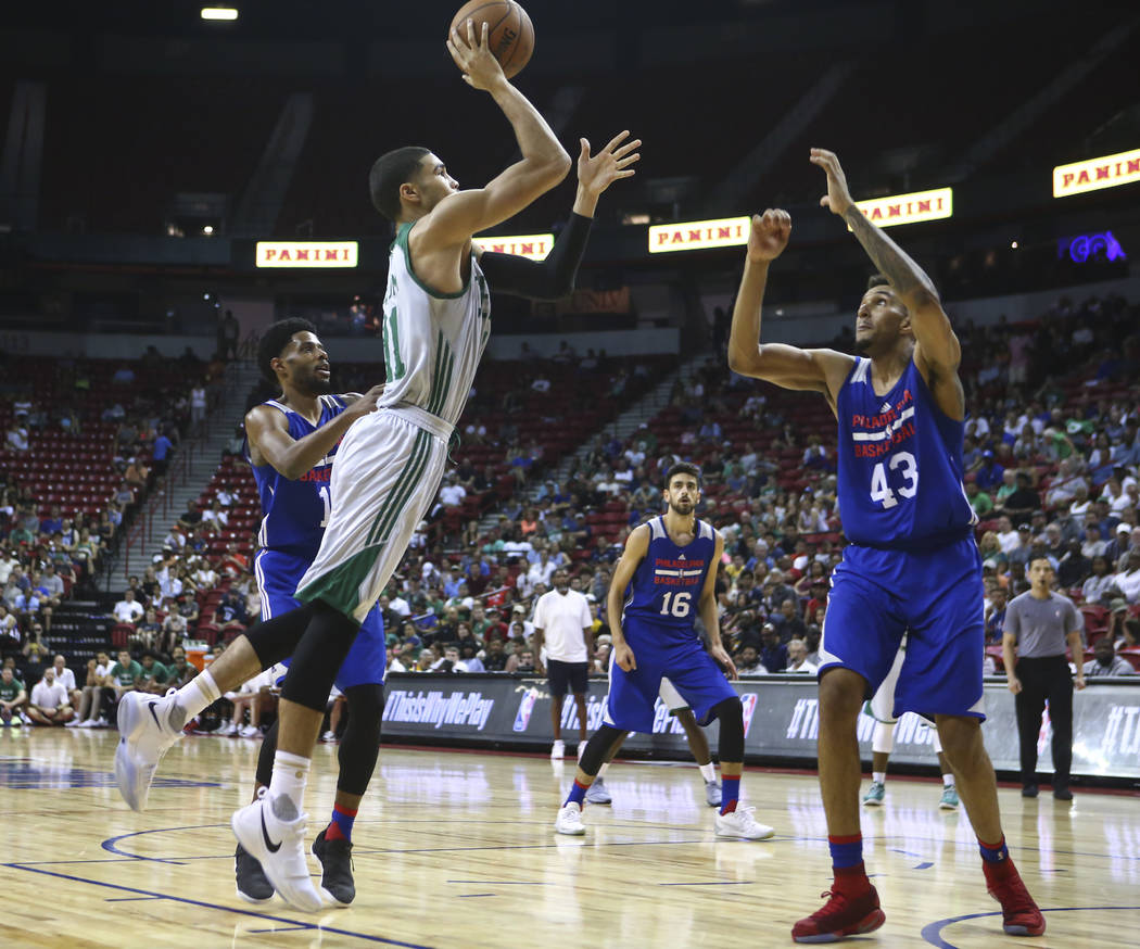 Boston Celtics' Jayson Tatum (11) shoots over Philadelphia 76ers' Jonah Bolden (43) during a basketball game at the NBA Summer League at the Thomas & Mack Center in Las Vegas on Tuesday, July  ...