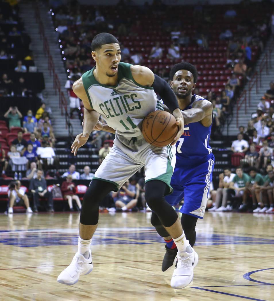 Boston Celtics' Jayson Tatum (11) drives to the basket against the Philadelphia 76ersmduring a basketball game at the NBA Summer League at the Thomas & Mack Center in Las Vegas on Tuesday, Jul ...