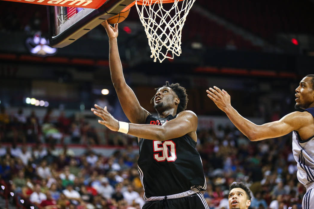 Portland Trail Blazers player Caleb Swanigan (50) goes up against Memphis Grizzlies player Vince Hunter during the NBA Summer League semifinal basketball game at Thomas and Mack Center on Sunday,  ...