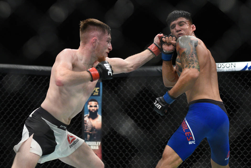 Brett Johns (red gloves) fights Albert Morales (blue gloves) during UFC Fight Night on July 16 in Glasgow, Scotland. (Per Haljestam-USA TODAY Sports)