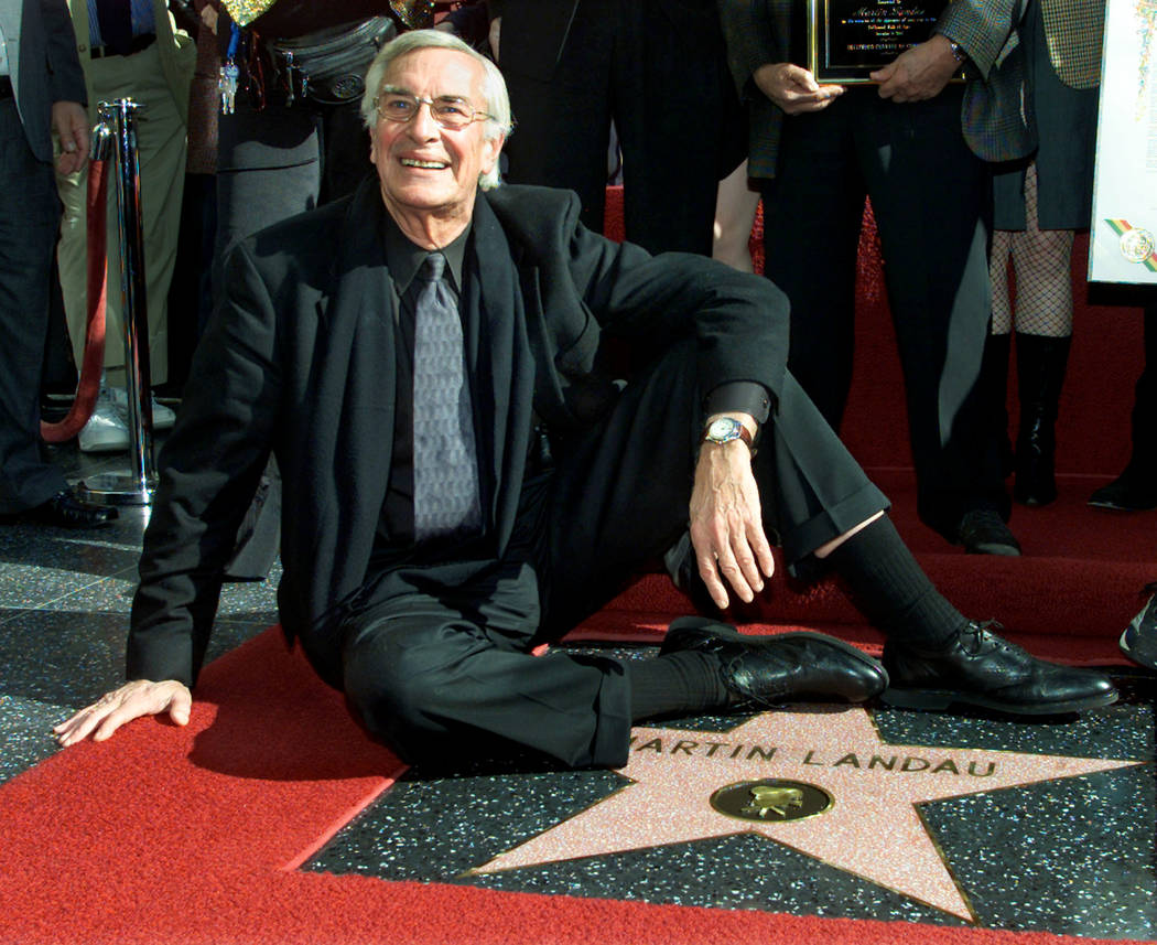 FILE PHOTO -  Academy award winning actor Martin Landau sits on his new star on the Hollywood Walk of Fame, as he poses for photographers during ceremonies to honor him, in Hollywood, December 17, ...