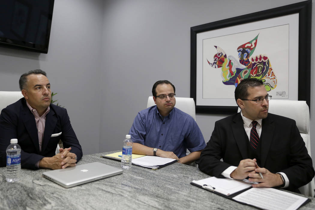 Attorney Andre Lagomarsino, left, meets with former officers of the Teachers Health Trust, who were terminated or left, executive assistant Michael Ielpi, center, and Director of Operations Philip ...