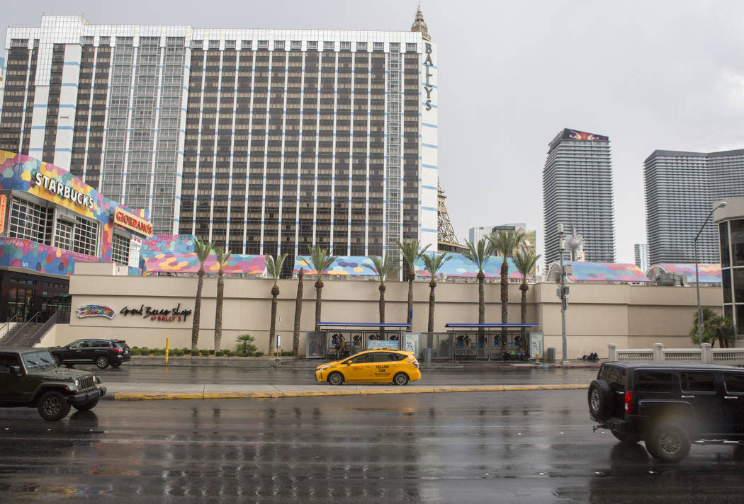 Cars drive on a wet Flamingo Road near Bally's during a rainstorm in Las Vegas on Monday, July 17, 2017.  Patrick Connolly Las Vegas Review-Journal @PConnPie