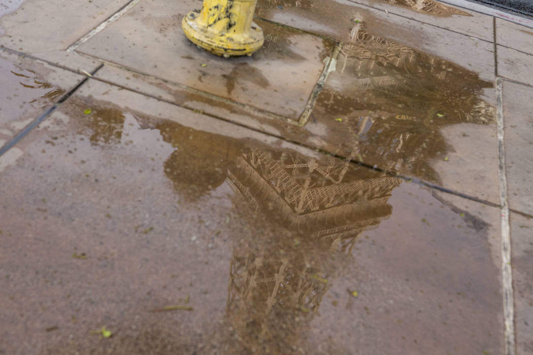 The Eiffel Tower at Paris Las Vegas is reflected in a puddle after a rainstorm on the Las Vegas Strip on Monday, July 17, 2017.  Patrick Connolly Las Vegas Review-Journal @PConnPie