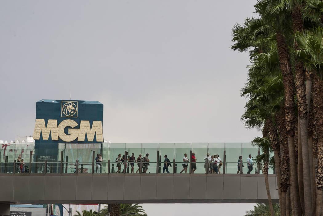 Pedestrians cross Las Vegas Boulevard near the MGM Grand after a rainstorm on the Las Vegas Strip on Monday, July 17, 2017.  Patrick Connolly Las Vegas Review-Journal @PConnPie