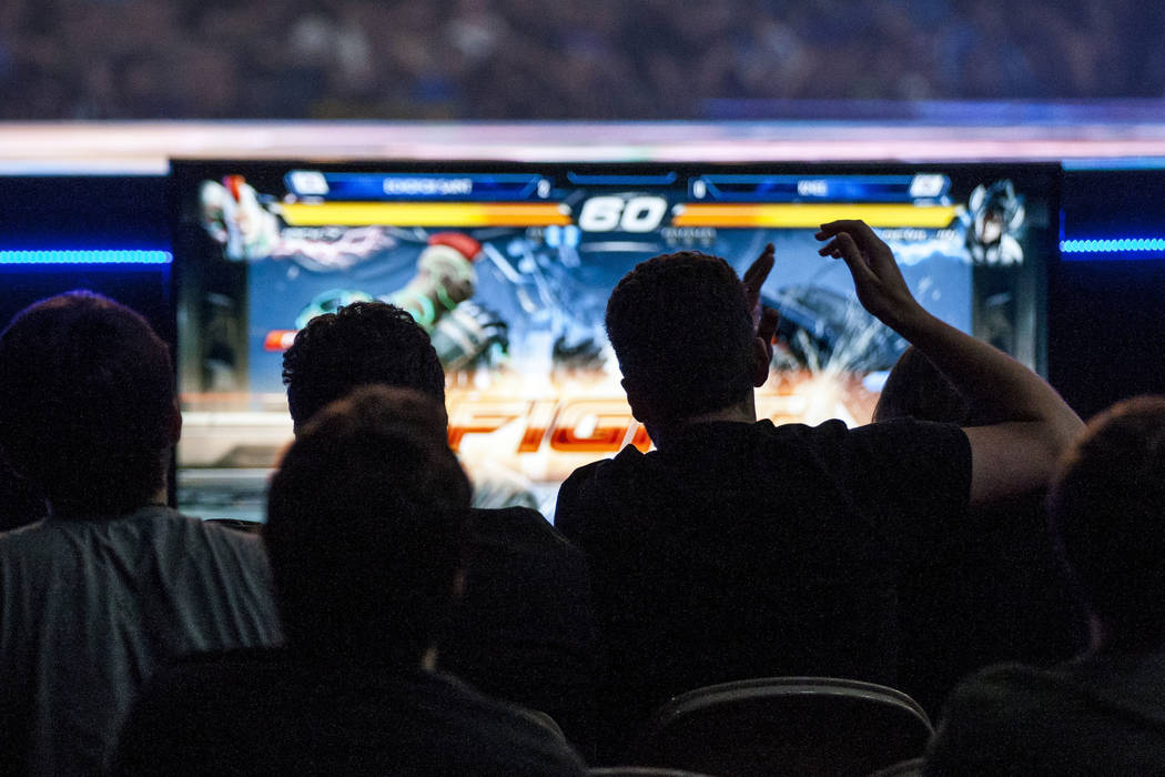 Spectators cheer as a fight begins in a round of Tekken 7 during the Evo 2017 Championship Series, a fighting game tournament, at the Mandalay Bay Events Center on Sunday, July 16, 2017.  Patrick  ...
