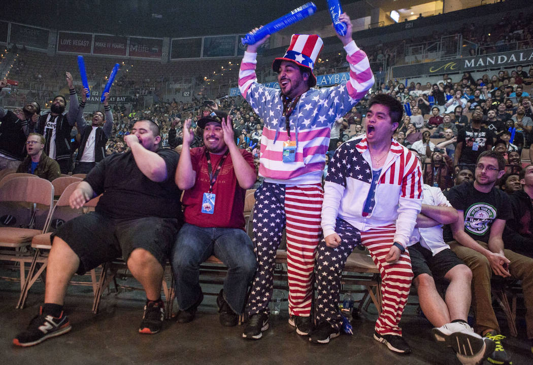 Atlanta Ngo, right, and Francisco Padilla, center right, cheer while sporting patriotic attire during the Evo 2017 Championship Series, a fighting game tournament, at the Mandalay Bay Events Cente ...