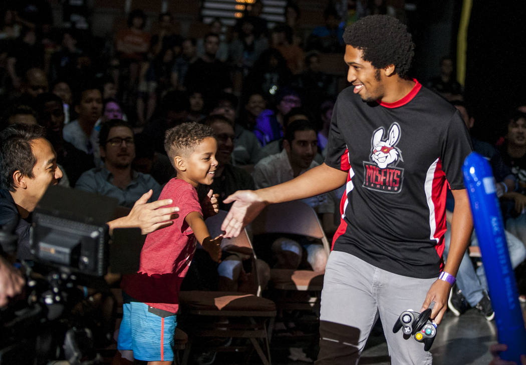 "Larry Holland aka ""Larry Lurr"" makes his entrance before playing Super Smash Bros. during the Evo 2017 Championship Series, a fighting game tournament, at the Mandalay Bay Events ..."