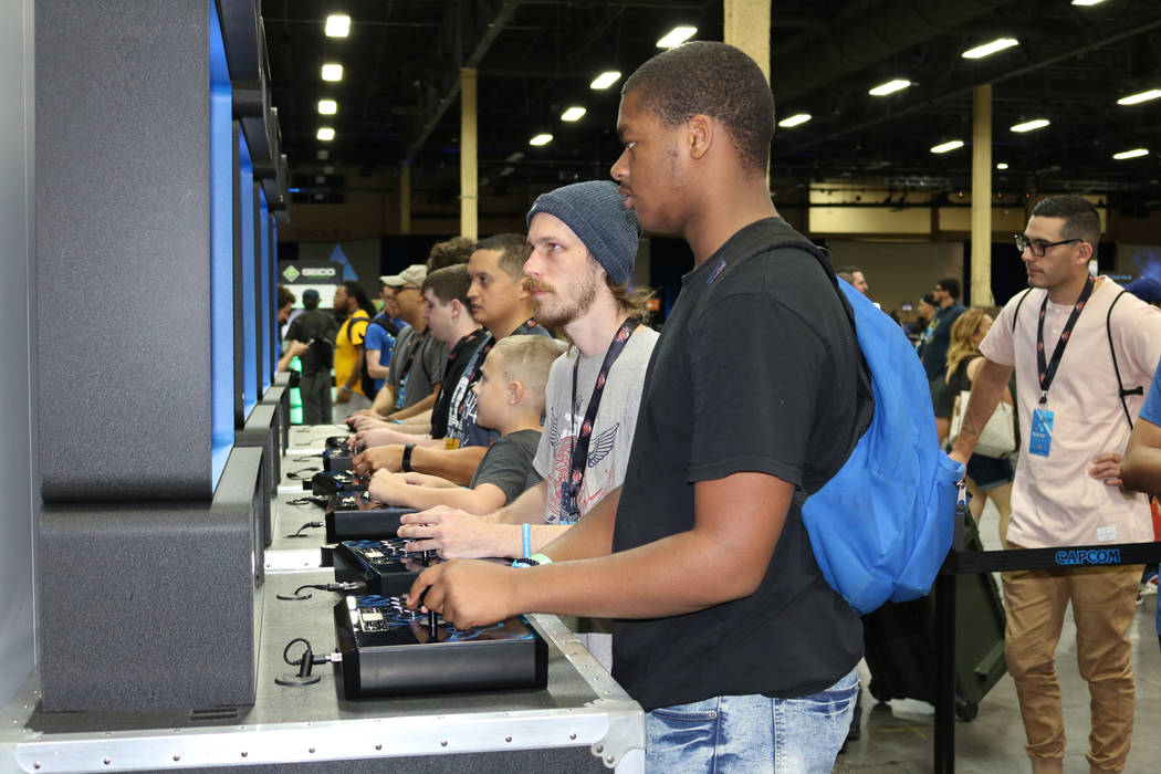 "Chris Swan, 28, known as Dynasty, in the gaming world plays the latest version of a video game called ""Marvel vs. Capcom: Infinite"" at the 2017 Evolution Championship Series Friday, July 14, 2017  ..."