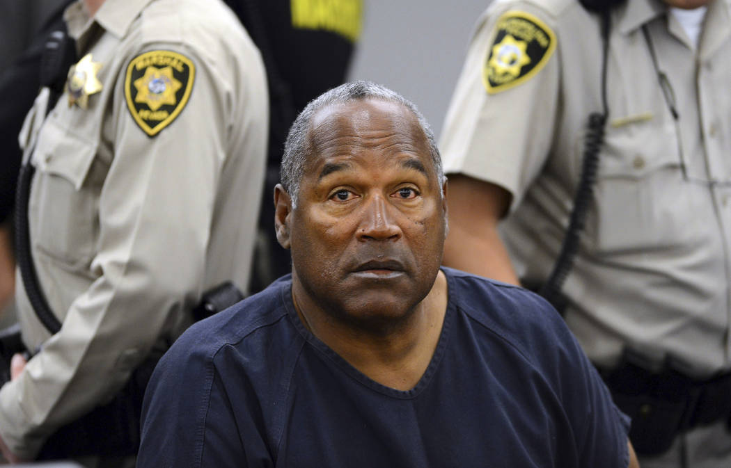 FILE - In this May 14, 2013 pool file photo, O.J. Simpson sits during a break on the second day of an evidentiary hearing in Clark County District Court in Las Vegas. (AP Photo/Ethan Miller, Pool, ...