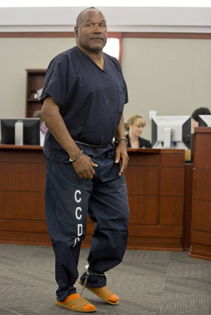 In this May 15, 2013 file photo, O.J. Simpson returns to the witness stand to testify after a break during an evidentiary hearing in Clark County District Court in Las Vegas. (AP Photo/Julie Jacob ...