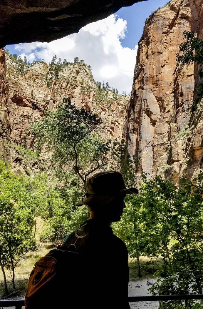 A man hikes along the Riverside Walk, which leads to The Narrows, a river hike through the Virgin River, at Zion National Park in Utah on Friday, July 14, 2017. (Patrick Connolly/Las Vegas Review- ...