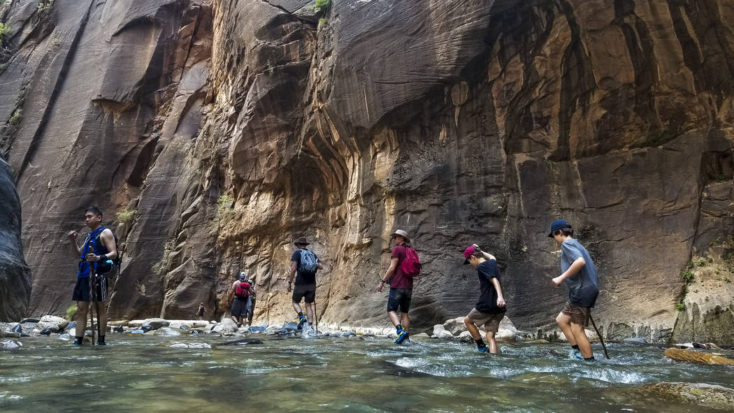 Zion National Park visitors walk along The Narrows, a river hike through the Virgin River, at Zion National Park in Utah on Friday, July 14, 2017. (Patrick Connolly/Las Vegas Review-Journal) @PConnPie