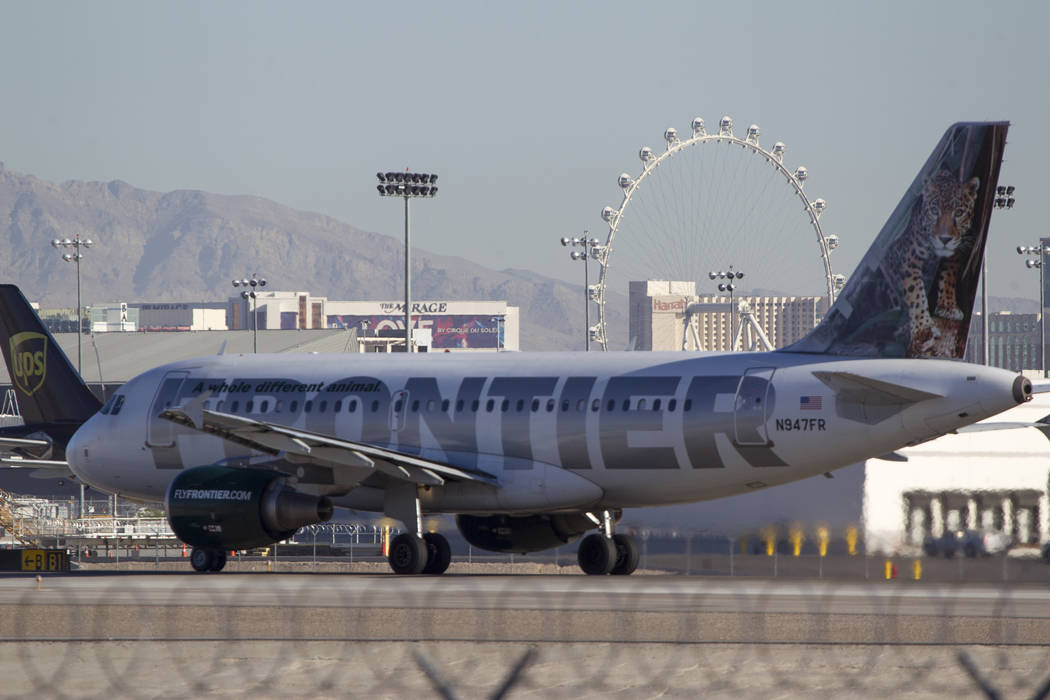 A Frontier Airlines jetliner taxis the runway at McCarran International Airport in Las Vegas on Wednesday, June 28, 2017. (Richard Brian/Las Vegas Review-Journal) @vegasphotograph