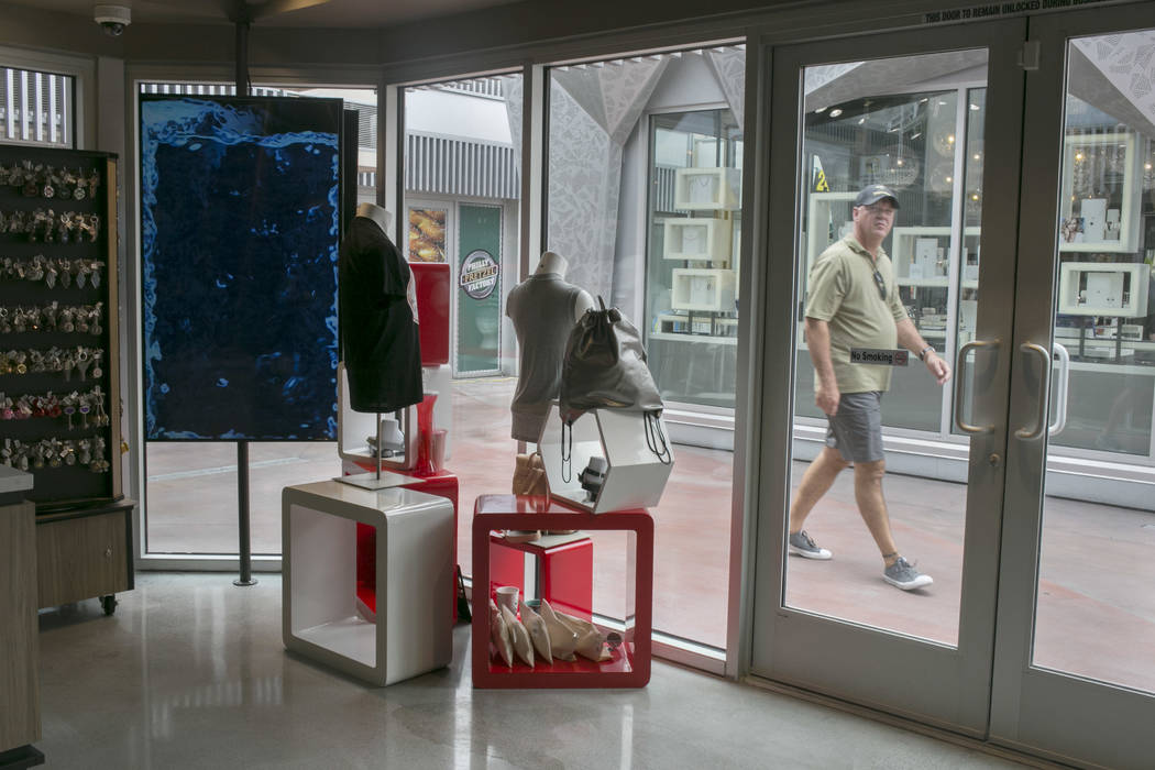 People walk by the front of Vegas EXP store in the Grand Bazaar Shops on the Strip in Las Vegas, Thursday, July 20, 2017. Vegas EXP will be the first interactive digital store in Las Vegas. (Gabri ...