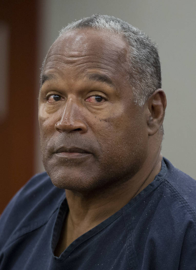 O.J. Simpson testifies during an evidentiary hearing in Clark County District Court, Wednesday, May 15, 2013 in Las Vegas. Simpson, who is currently serving a nine to 33-year sentence in state pri ...