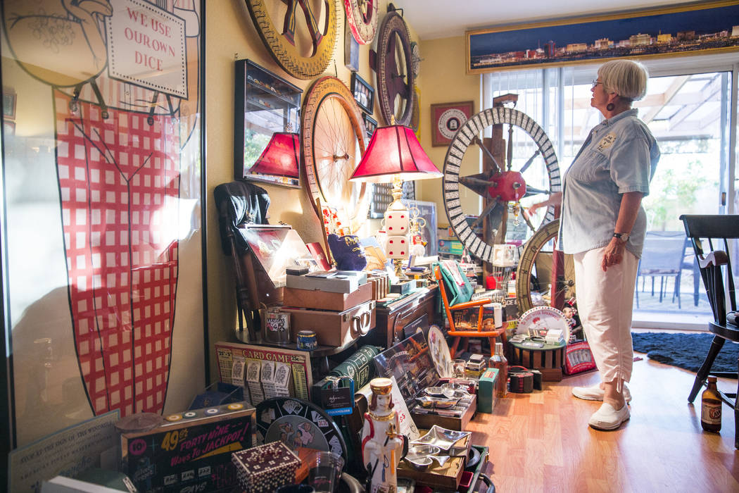 Christie Smith standing in front of her casino collection. (Todd Prince/Las Vegas Review-Journal)